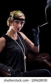 Twenties lady smoking a cigarette with a cigarette holder