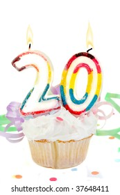twentieth birthday cupcake with white frosting on a white  background