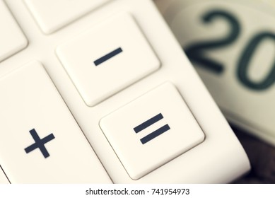 Twenty Bill Money Equal. Shallow depth of field. Selective focus on Equal button