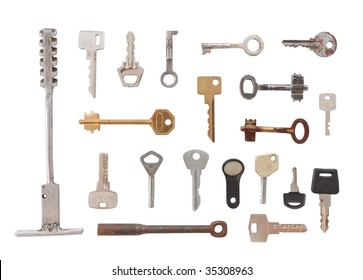 Twenty different types of keys big and small, old and new, self-made, rusty, for cases, gate, cases, etc. Isolated on white