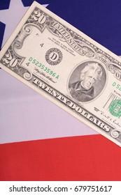 twenty dollar bill in front of the American flag
