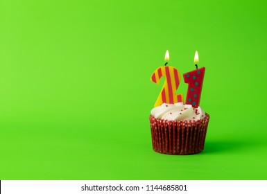 Twenty First Birthday Cupcake With Candles Number 21 On Green Background