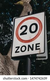 Twenty miles per hour speed limit zone sign on the road in Brixton, Borough of Lambeth, London, UK.