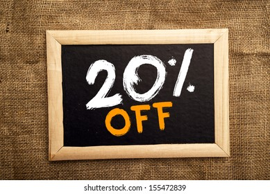 Twenty percent off, discount tag on blackboard.