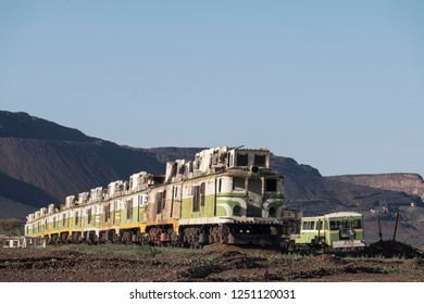 twenty rusty french 1960 diesel locomitives abandoned in the desert of mauritania