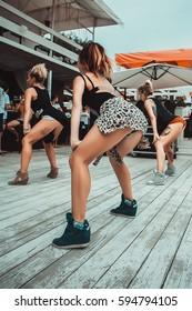 Twerk girls dancing on the beach during the dance class on open air