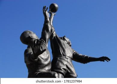 Twickenham, London / UK - July 2020: the bronze sculpture 'Line-out' by Gerald Laing, at Twickenham Stadium, London UK