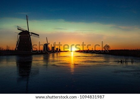Twight light sunrise on the Unesco heritage windmill silhouette at the middle of the canal, Alblasserdam, Netherlands