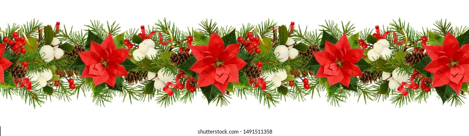 Twigs of Christmas tree, poinsettia flower, berries and holiday decorations in seamless garland isolated on white. Flat lay. Top view.