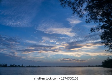 Twilight - a beautiful sky of blues and wispy clouds -  as the sun sets, over the mighty Clarence River; taken during springtime, while fishing from Goodwood Island, NSW, Australia.