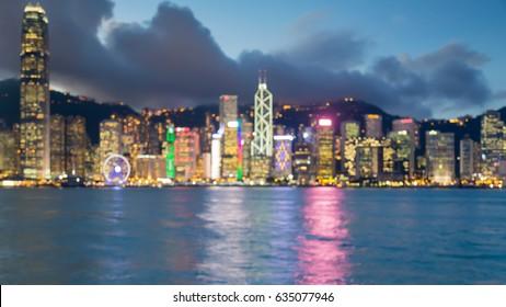 Twilight blurred bokeh light Hong Kong business downtown, abstract background