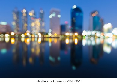 Twilight blurred bokeh lights offcie building, abstract background