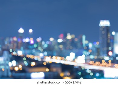 Twilight blurred light office building and road, abstract background
