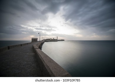 Twilight in Cadiz city Andalusia Spain Caleta beach and San Sebastian castle
