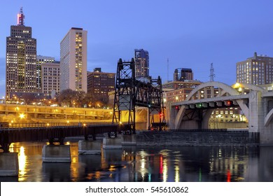 Twilight City Lights in St Paul with Car and Rail Traffic Bridges over the Mississippi River in the Foreground