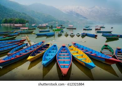 twilight with color boats on Phewa lake, Pokhara, Nepal