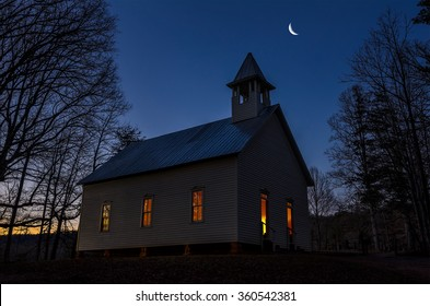 Twilight with crescent moon over primitive church in the Great Smoky Mountains National Park