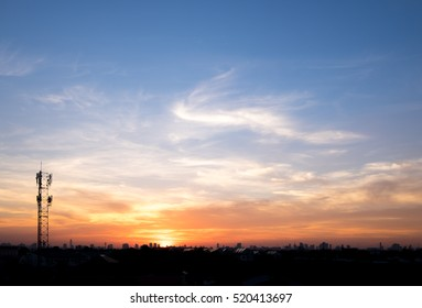 Twilight evening with colorful vivid cloud in the blue sky. Afternoon sunset sunrise and city silhouette background.