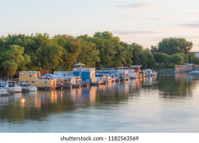 Twilight image of Mississippi River from Raspberry Island. sunset with house boats, tree lined smooth river scene