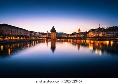 Twilight landscape sunset of city reflect by water in Luzern Switzerland