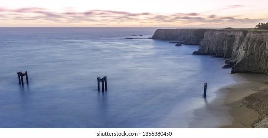 Twilight over Davenport Old Pier Bluffs. Davenport, Santa Cruz County, California, USA.