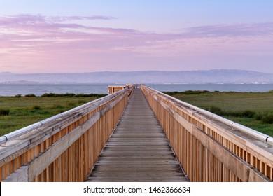 Twilight over the new boardwalk at Baylands Nature Preserve. Palo Alto, Santa Clara County, California, USA.