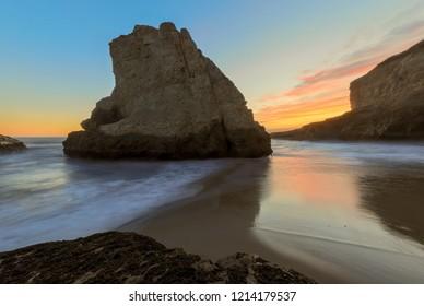 Twilight over Shark Fin Cove (Shark Tooth Beach). Davenport, Santa Cruz County, California, USA.