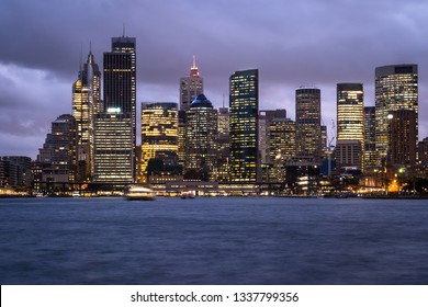Twilight over the Sydney downtown district skyline by the Sydney harbor in Australia largest city.