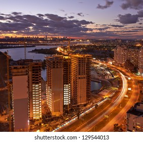 Twilight panoramic cityscape. Aerial view. Typical modern residential area.