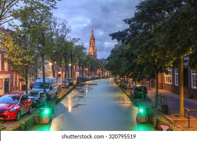 Twilight scene in Delft along the Oosteinde canal with the Nieuwe Kerk (New Church) in the background.