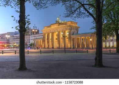 Twilight scene of the famous Brandenburg Gate in Berlin, Germany.