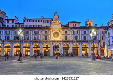 Twilight scene in Piazza della Loggia, Brescia, Italy featuring the Astronomical Tower on its east side.