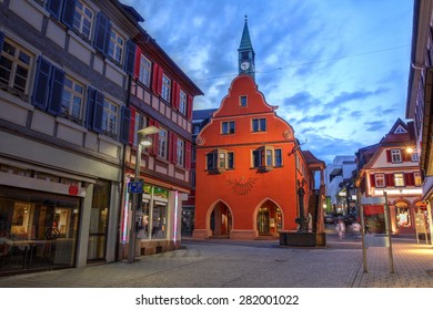 Twilight scene in the small town of Lahr in the Black Forest, Germany (province of Baden Wurttemberg) with focus on the red building of the Town Hall.