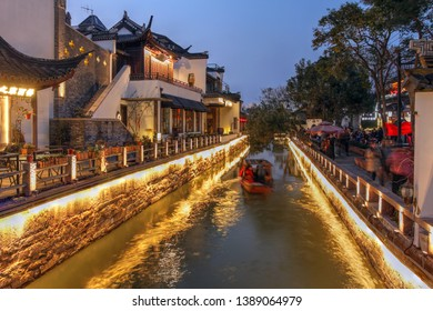 Twilight scene in Suzhou, China with historical houses along the canals.