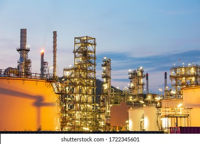 Twilight scene of tank oil refinery plant and tower column of Petrochemistry industry in site construction