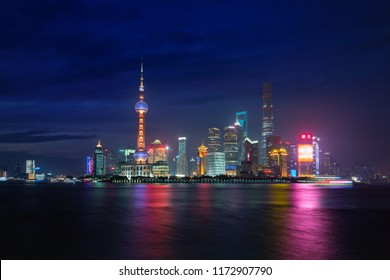 Twilight shot with the Shanghai skyline and the Huangpu river in Shanghai, China