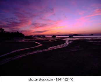 Twilight silhouette seascape view, line of beauty on the beach, with colorful twilight coulds and sky, so beautiful, space for the text