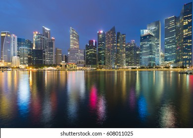 Twilight, Singapore office building central business downtown sea front, cityscape downtown background