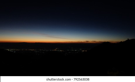 Twilight sky after sunrise, Mountain landscape, Natural Sunset Sunrise Over Field Or Meadow. Bright Dramatic Sky And Dark Ground. Countryside Landscape Under Scenic Colorful Sky At Sunset Dawn Sunrise