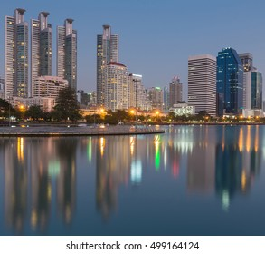 Twilight sky, city  office building and water reflection, Bangkok Thailand