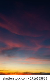Twilight sky with dark blue and colorful orange and purple sunlight cloud fluffy, Dusk sky vertical.