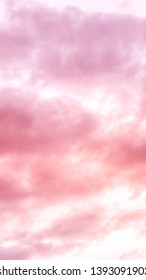 Twilight sky with effect of living coral  colors. Colorful sunset of soft clouds. 9:16 Aspect Ratio
