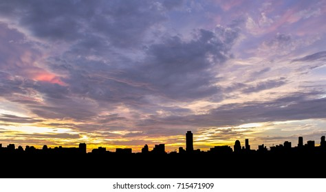 Twilight sky in evening with silhouette city. / Beautiful sky and silhouette city. / Abstract Background.