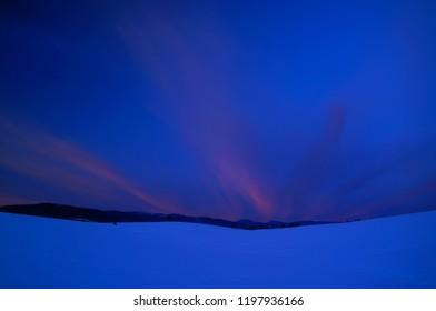 Twilight sky on the snow, Asiago plateau, Italy