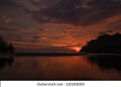 Twilight sky and orange clouds reflect the sea (Koh Kood, Trat, Thailand)