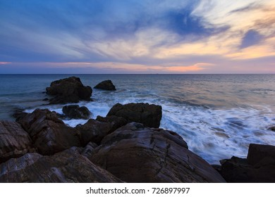 twilight sky over the sea with silhouette rocky shore, Phang Nga, Southern Thailand