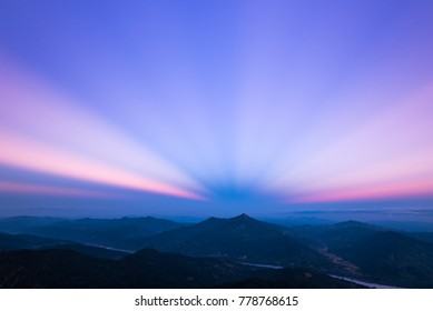 Twilight sky with strange light in the evening on 102 hill of Doi pha tang, Chiang rai, Thailand