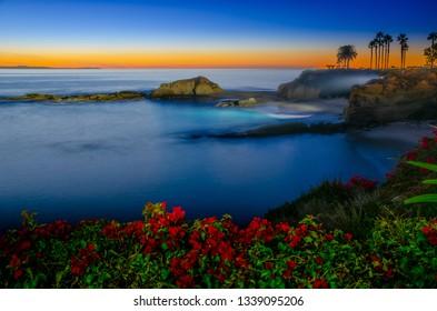 Twilight sunset at Goff Cove, in Laguna Beach, Orange County, California, USA.