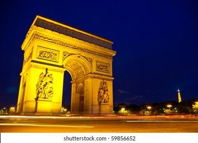 Twilight view of the Arch de Triump in paris, France