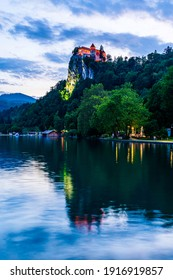 Twilight view of the castle of Bled with reflections onto Lake Bled. Medieval Bled castle in Slovenia